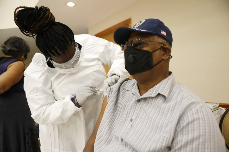 A healthcare worker administers the COVID-19 vaccine to a resident living in the Jackson Heights neighborhood at St. Johns Missionary Baptist Church in Tampa, Fl., on Jan. 10, 2021.
