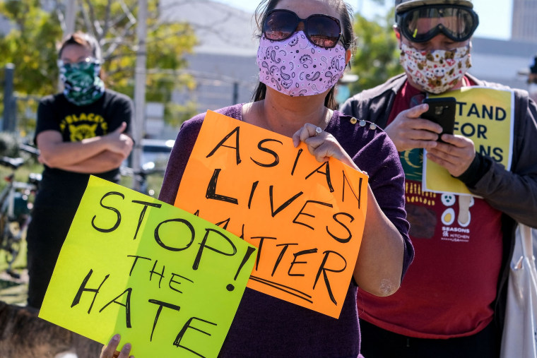 Demonstrators take part in a rally to raise awareness of anti-Asian violence in Los Angeles on Feb. 20, 2021.