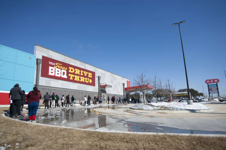 February 19, 2021: People wait in line to enter H-E-B supermarket in Austin. Austin, Texas.