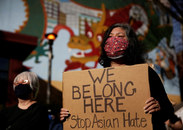 Carol Narasaki attends a protest against anti-Asian hate crimes at Hing Hay Park in the Chinatown-International District of Seattle on March 13.