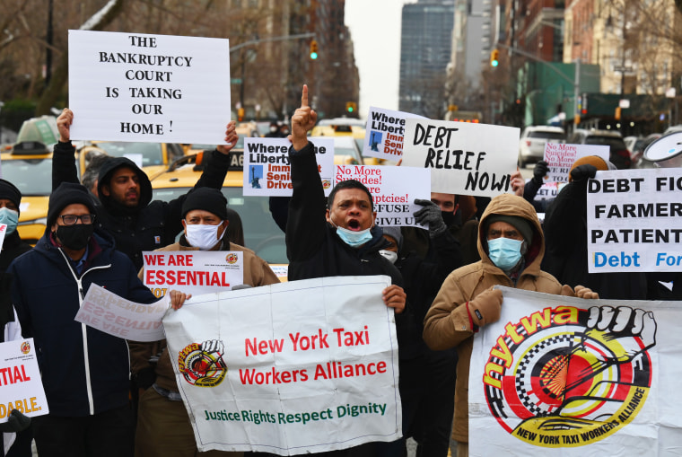 Yellow cab taxi drivers block traffic in a protest demanding debt forgiveness for cabbies hit hard by the coronavirus pandemic in New York on Feb. 10.