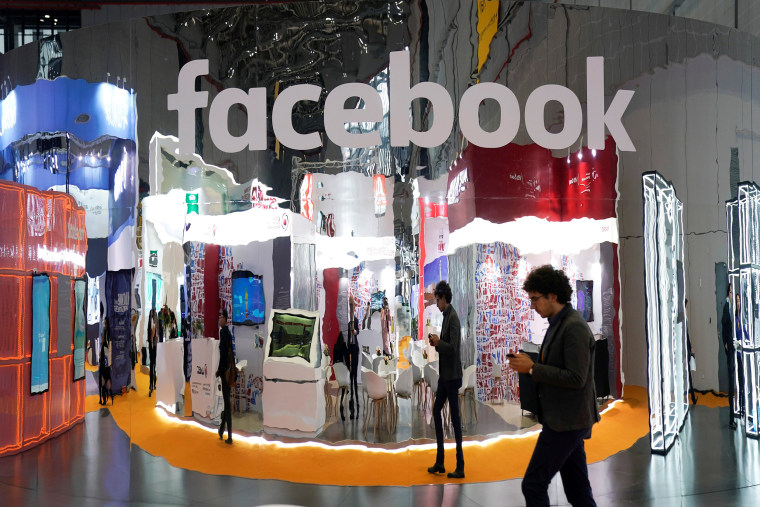 Image: A Facebook sign at the National Exhibition and Convention Center in Shanghai.