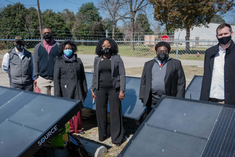 South Carolina State Rep. Robert Williams, left; Xavier Boatright of All Aboard for Justice; Mayor of Florence Teresa Myers Ervin; Dr. Florence Anoruo of South Carolina State University, Rev. Leo Woodberry, pastor, Kingdom Living Temple; Colin Goddard, director, SOURCE Global atthe church's initial installation of hydropanels.