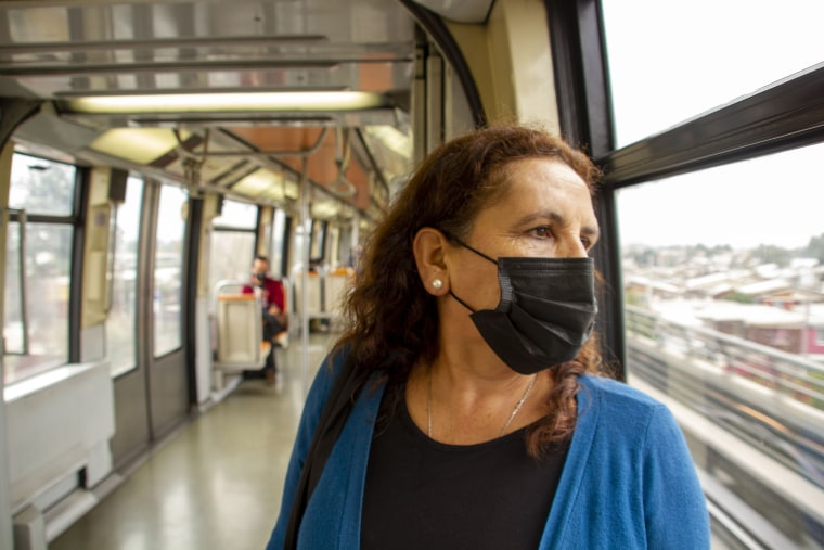 Genoveva Fernández Rodríguez rides the subway on her way to get vaccinated in Santiago, Chile, on March 25, 2021.