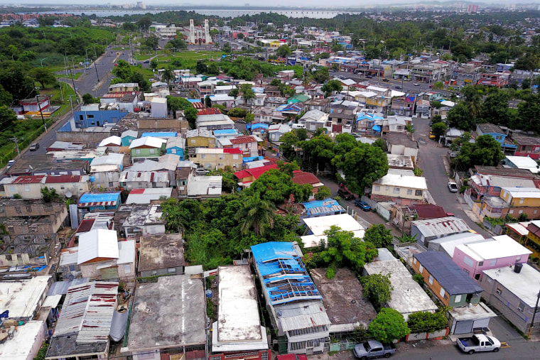 Image: Blue tarps given out by FEMA cover several roofs two years after Hurricane Maria affected the island in San Juan, Puerto Rico, on Sept. 18, 2019.