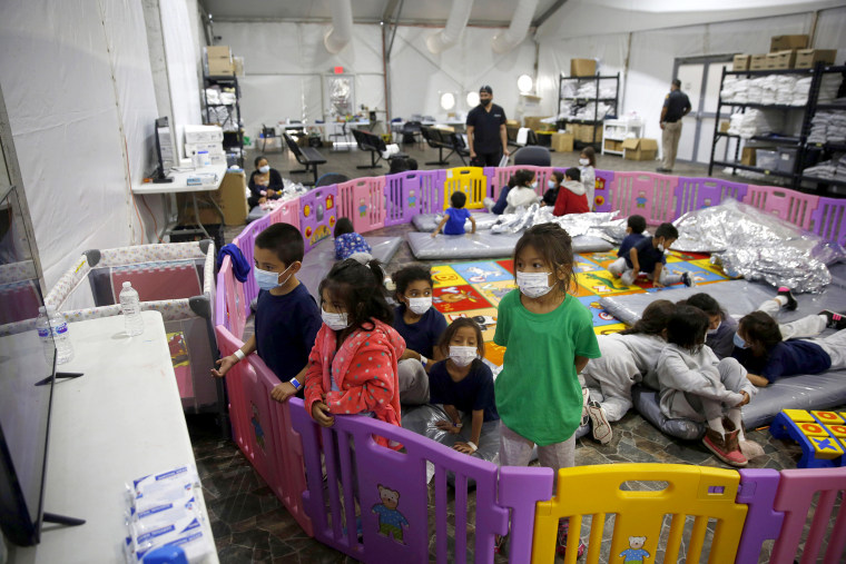 Image: Young unaccompanied migrants, from ages 3 to 9, watch television inside a playpen at the U.S. Customs and Border Protection facility, the main detention center for unaccompanied children in the Rio Grande Valley, in Donna, Texas on March 30, 2021.
