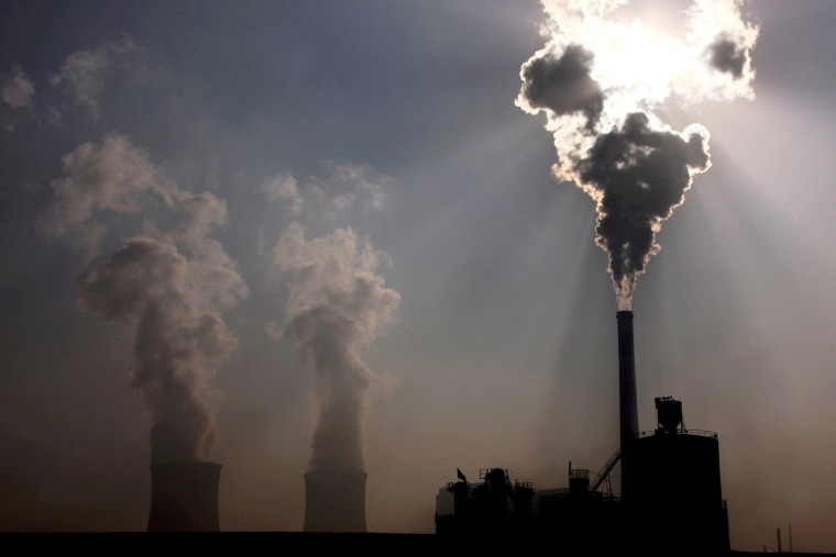 A coal-burning power plant behind a factory in China's Inner Mongolia Autonomous Region.