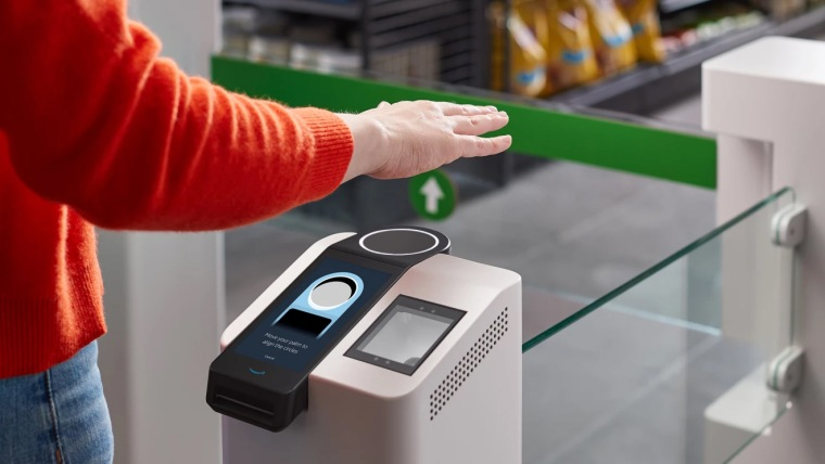 Amazon will be bringing its Amazon One palm scanning payment system to its Whole Foods stores.