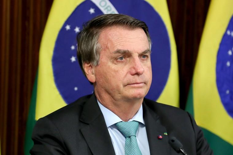 Image: Brazil's President Bolsonaro attends a virtual global climate summit via a video link in Brasilia