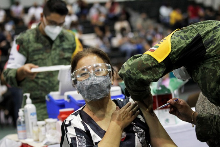 A school worker receives a dose of China's CanSino Covid-19 vaccine during a mass vaccination event on the outskirts of Monterrey, Mexico, on April 27, 2021.