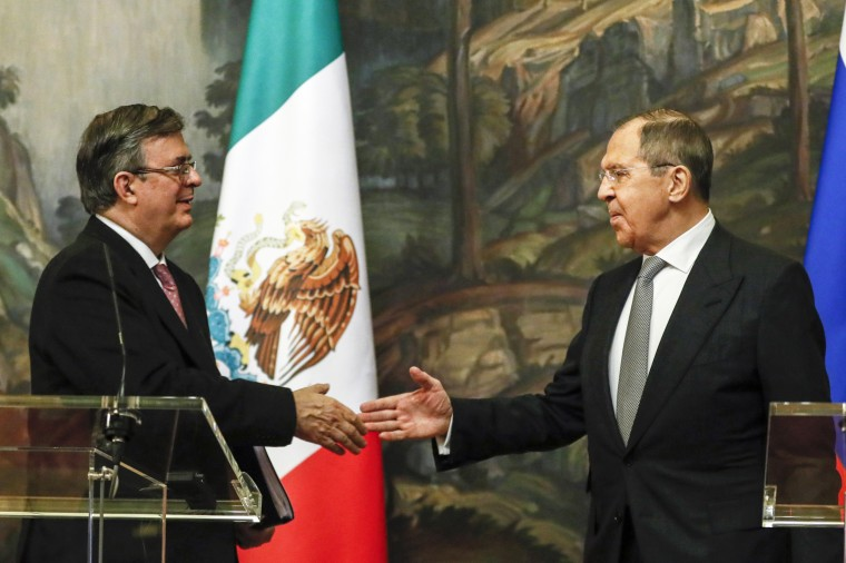 Russian Foreign Minister Sergey Lavrov, right, and Mexican Foreign Minister Marcelo Ebrard shake hands after their meeting in Moscow on April 28, 2021.