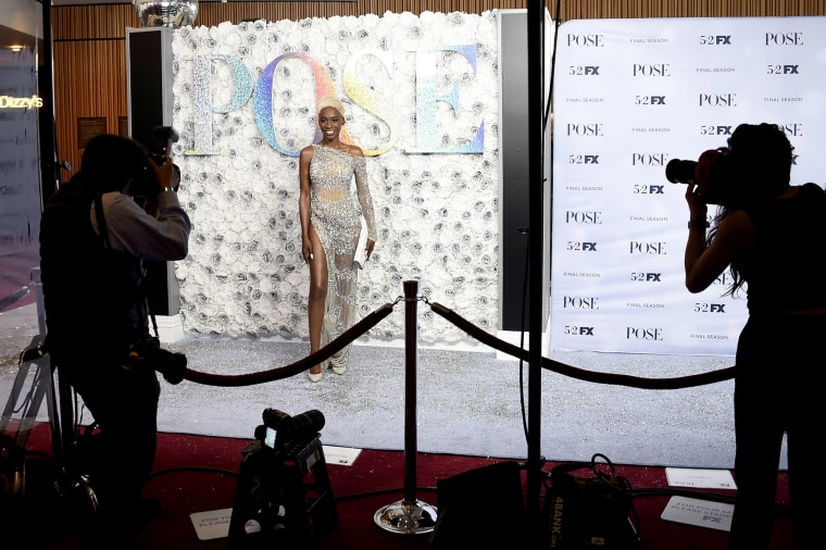 """Image: Photographers cover the red carpet in a socially distanced manner at FX's """"Pose"""" third and finale season premiere at Jazz at Lincoln Center on April 29, 2021, in New York."""