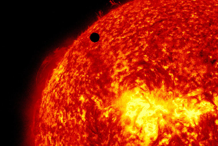 Venus transits across the face of the sun at on June 5, 2012.