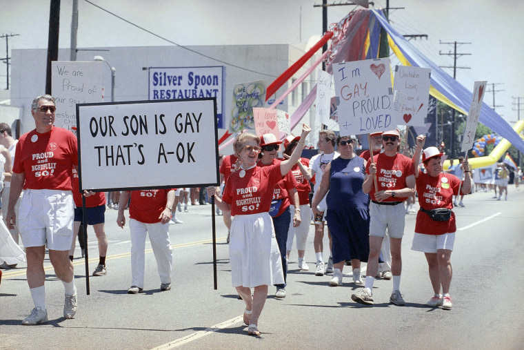 Image: Parents march in a show of unity during the Los Angeles Gay and Lesbian Pride Parade on June 23, 1990.