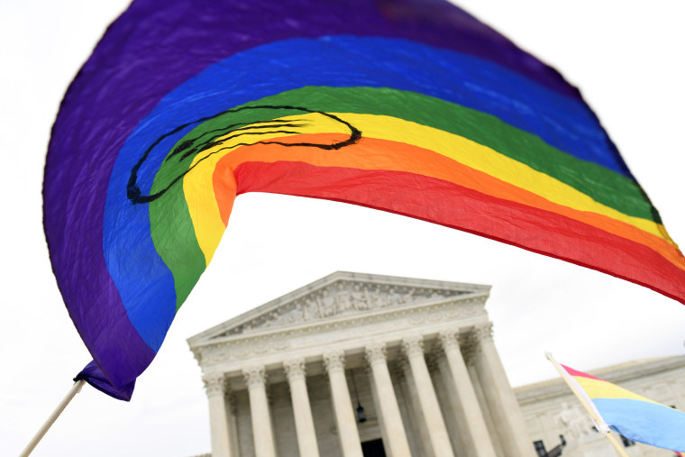 Supporters of LGBTQ rights gather outside the Supreme Court in Washington on Oct. 8, 2019.