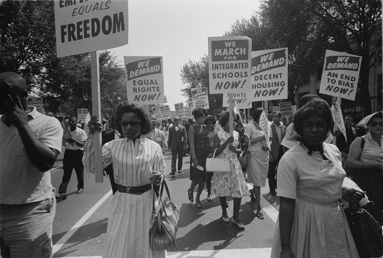 A procession of protesters carrying signs for equal rights, integrated schools, decent housing, and an end to bias in Washington, D.C., on Aug. 28, 1963.