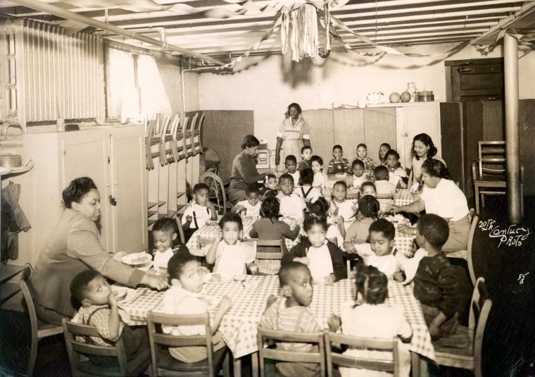 Children sit at a segregated day care center in Evanston, Il., in 1940.