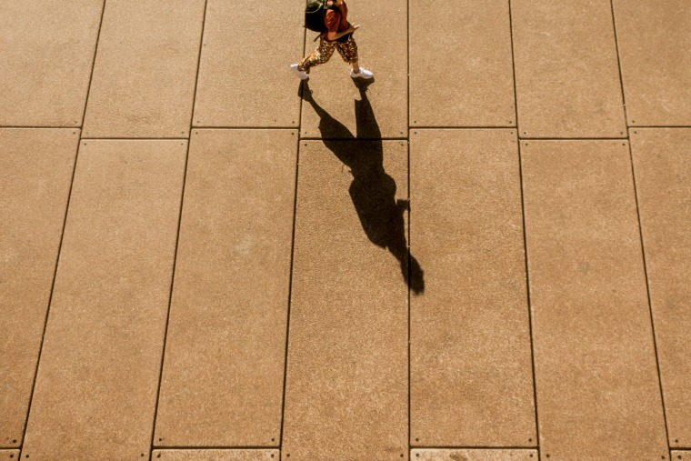 A Long Shadow of a Person Walking