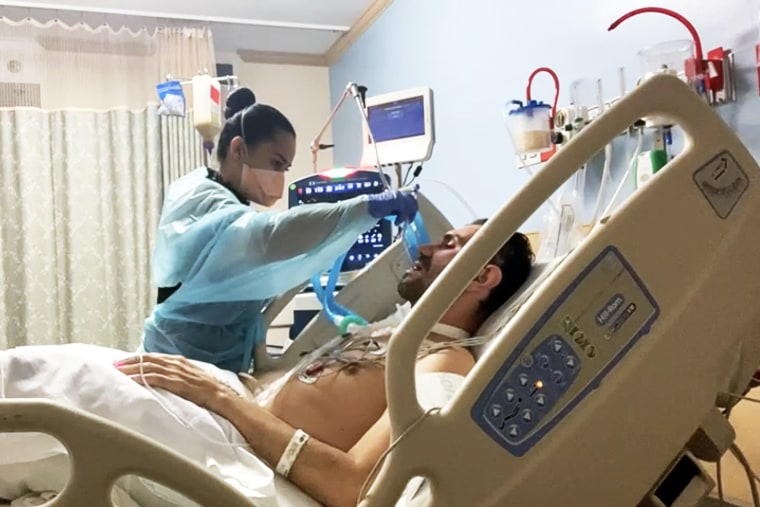 Solangi Urueña helps her husband, Hernando Rodríguez, in the hospital after he contracted Covid-19 and Guillain-Barré syndrome.