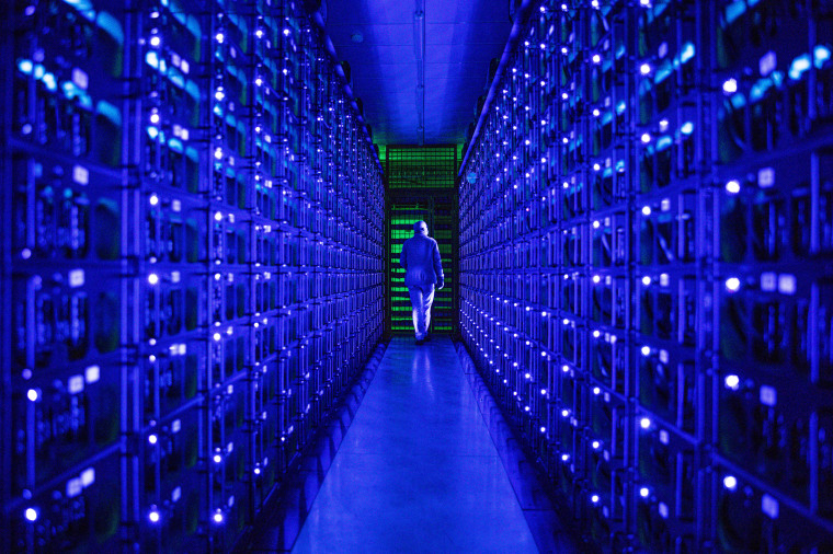 Mining rigs mine the Ethereum and Zilliqa cryptocurrencies at the Evobits crypto farm in Cluj-Napoca, Romania, on Jan. 22, 2021.