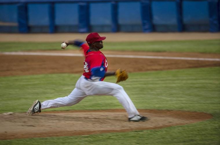 Image: Cuba's pitcher Yoanni Yera Montalvo throws the ball during a training session at the Estadio Latinoamericano in Havana, Cuba, on May 18, 2021.