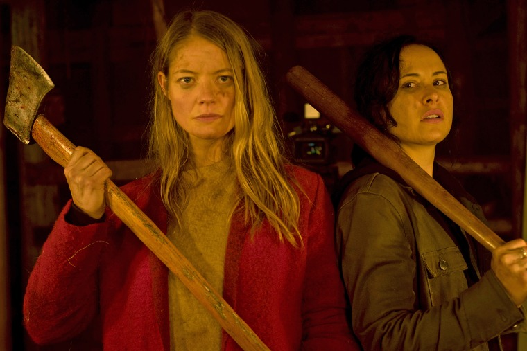 """Sarah Allen, left and Tommie-Amber Pirie in """"The Retreat"""" play a couple who spend a romantic weekend at a remote cabin in the woods. They end up having to fight for their lives."""