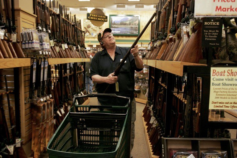 Sherrod browses for guns at the Cabela's store in Fort Worth