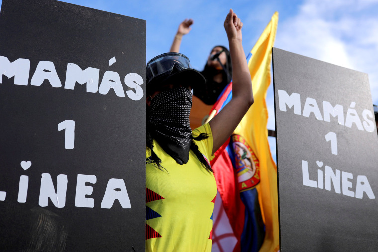 """Image: A woman who is part of the group of """"Mothers of the first line"""" reacts during a protest demanding government action to tackle poverty, police violence and inequalities in healthcare and education systems, in Bogota"""