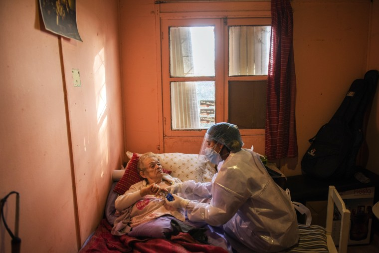 Image: Doctor checks on COVID-19 patient at her home in Montevideo, Uruguay,