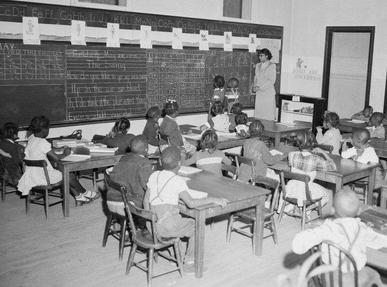 Third graders study arithmetic in Atlanta's C.W. Hill school c. 1954. Critical race theory seeks to highlight how historical inequities and racism continue to shape public policy and social conditions today.