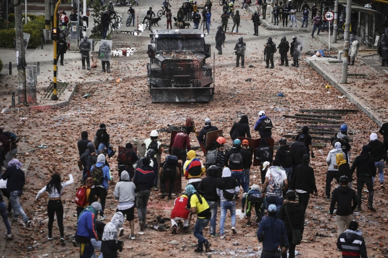 Anti-government protesters clash with riot police in Madrid, on the outskirts of Bogota, Colombia, on May 28, 2021.