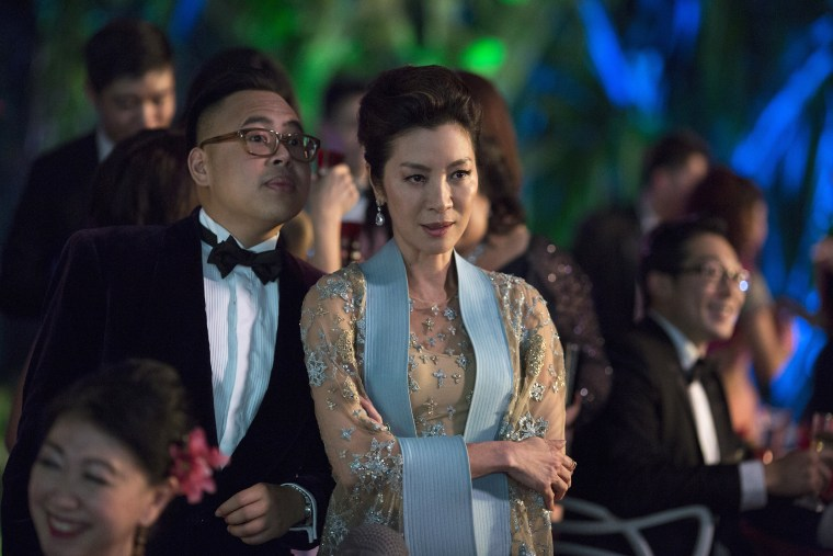 """Nico Santos as Oliver and Michelle Yeoh as Eleanor in """"Crazy Rich Asians."""""""