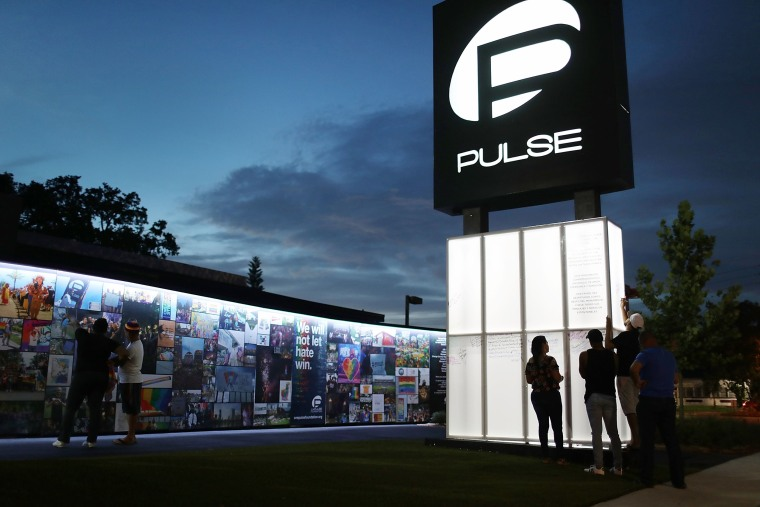 Image: Visitors at the memorial to the shooting victims setup at the Pulse nightclub in Orlando, Fla., on June 11, 2018.