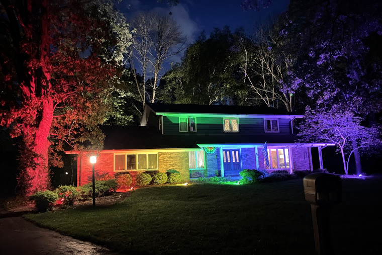 The house of Memo Fachino and Lance Mier lit in rainbow lights.