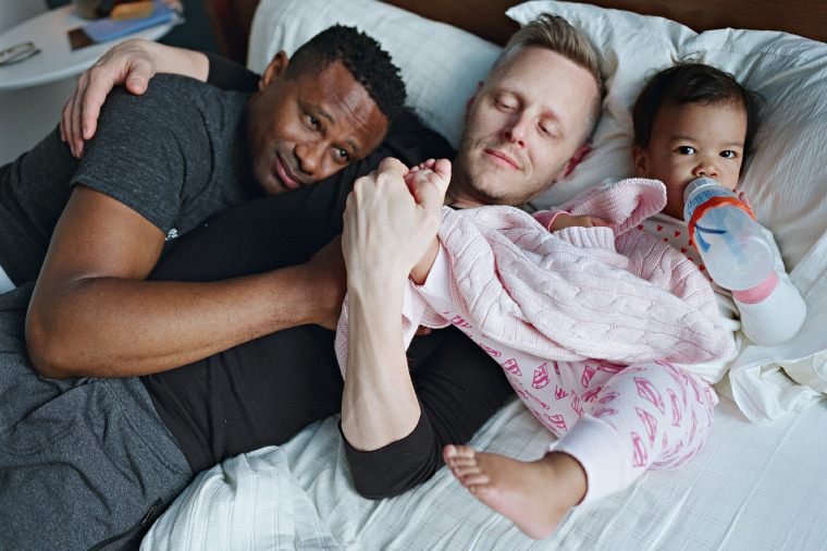 Harrison and Christopher with their daughter Genhi in Brooklyn, N.Y.