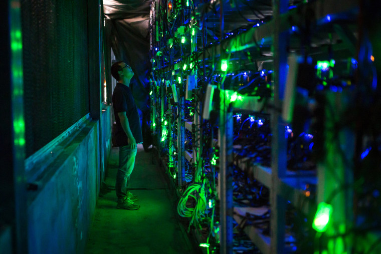 Haobtc's bitcoin mine site manager, Guo-hua, checks mining equipment inside their bitcoin mine near Kongyuxiang, Sichuan, China, on Aug. 12, 2016.