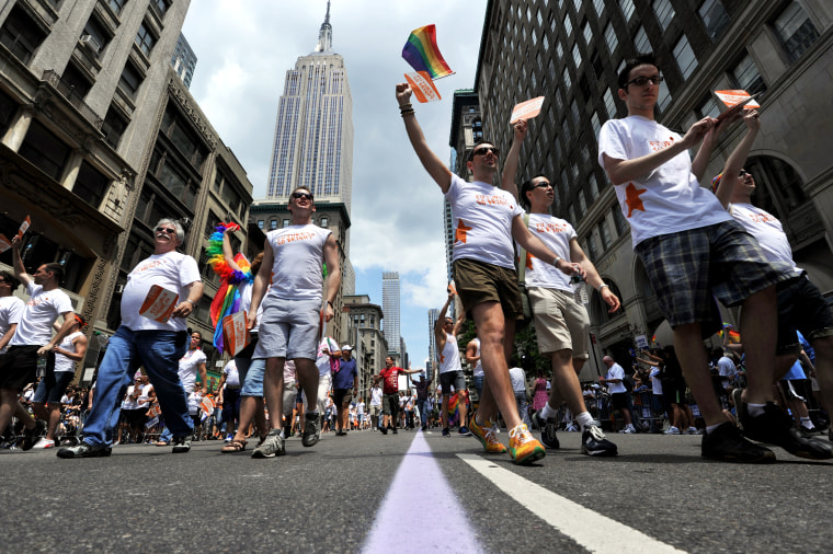 A group walks down Fifth Avenue during t