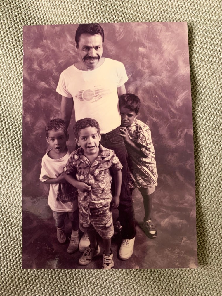 Louis Arce with his children Joey, Angel and Noel.