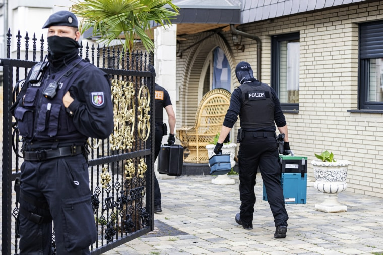 A police officer guard a house in Leverkusen, Germany, on June 8, 2021.