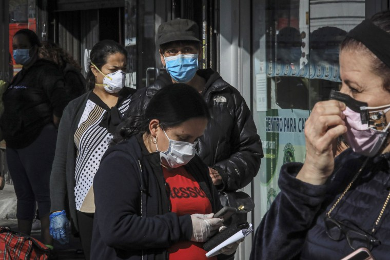 People in Sunset Park, a Brooklyn neighborhood with one of New York''s largest Mexican and Hispanic communities, wear masks while waiting in line at the height of the pandemic in May, 2020.