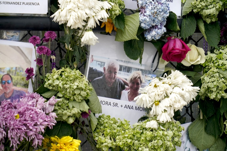 Image: A memorial wall for the victims of the Champlain Towers South building collapse in Surfside, Fla., with a photo of Juan Mora Sr. and his wife, Ana Mora, on June 29, 2021.