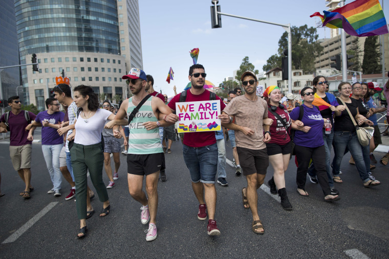 Image: LGBT community members block a highway during a protest in Tel Aviv