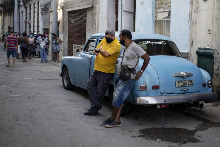 Image: A man looks at his cell phone in Havana July 13, 2021.