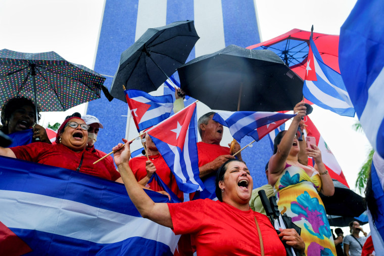 Image: Cuban emigres in the Little Havana neighborhood gather following reports of protests in Cuba against its deteriorating economy, in Miami on July 13, 2021.