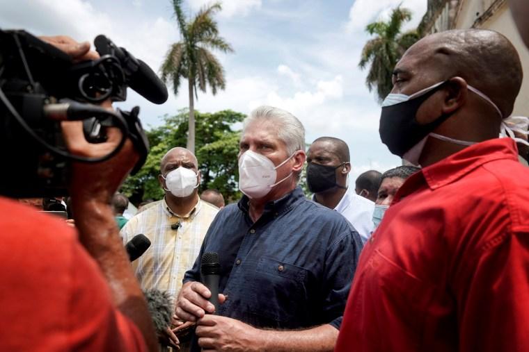 Image: Cuba's President Miguel Diaz-Canel talks to the media, in San Antonio de los Banos