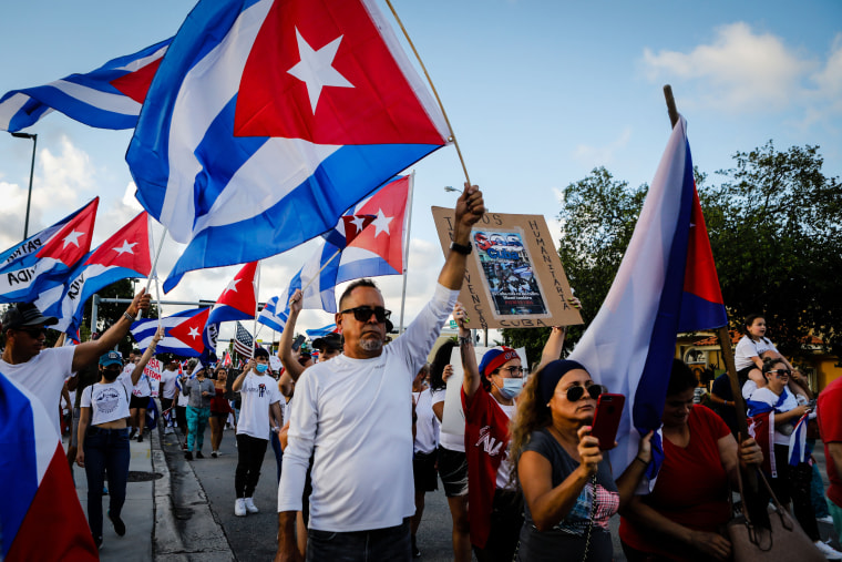 People hold Cuban flags during a protest showing support for Cubans demonstrating against their government, in Hialeah, Fla., on July 15, 2021.