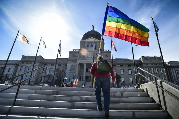 Demonstrators gather on the steps of the Montana State Capitol to protest anti-LGBTQ legislation in Helena, on March 15.