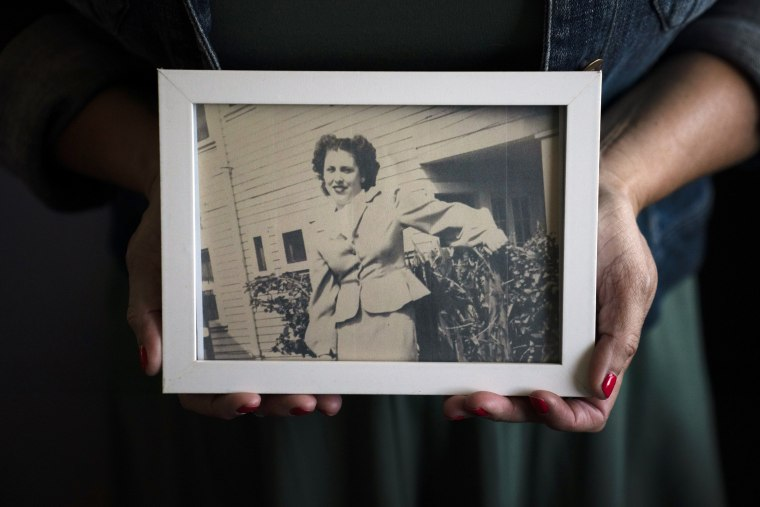 Stacy Cordova, whose aunt was a victim of California's forced sterilization program that began in 1909, holds a framed photo of her aunt Mary Franco on July 5, 2021, in Azusa, Calif.