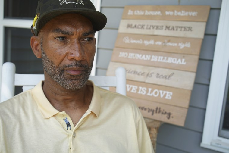 Image: Alton Lucas sits on the porch of his home outside of Raleigh, N.C., on June 18, 2021.