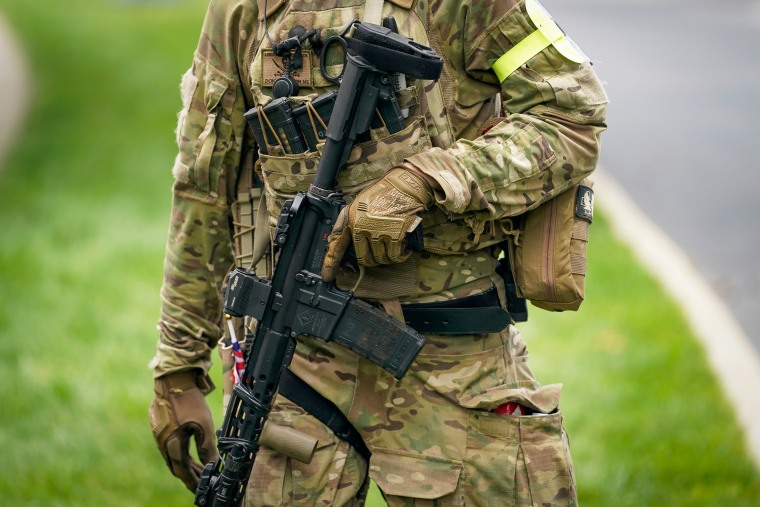 A member of the Three Percenters militia provides security a gun rights rally in Frankfort, Ky, on May 24, 2020.